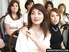 Asian floozy shows panties to hand orgy