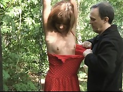 Teenager slave bound smacked and fucked in the forest