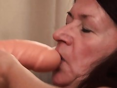 Grannie likes fucking her big toy and show it all